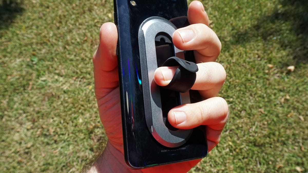 The Ohsnap phone grip in hand.