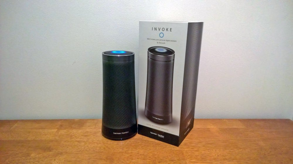 A Harmon Kardon Invoke Cortana-powered speaker next to its box.