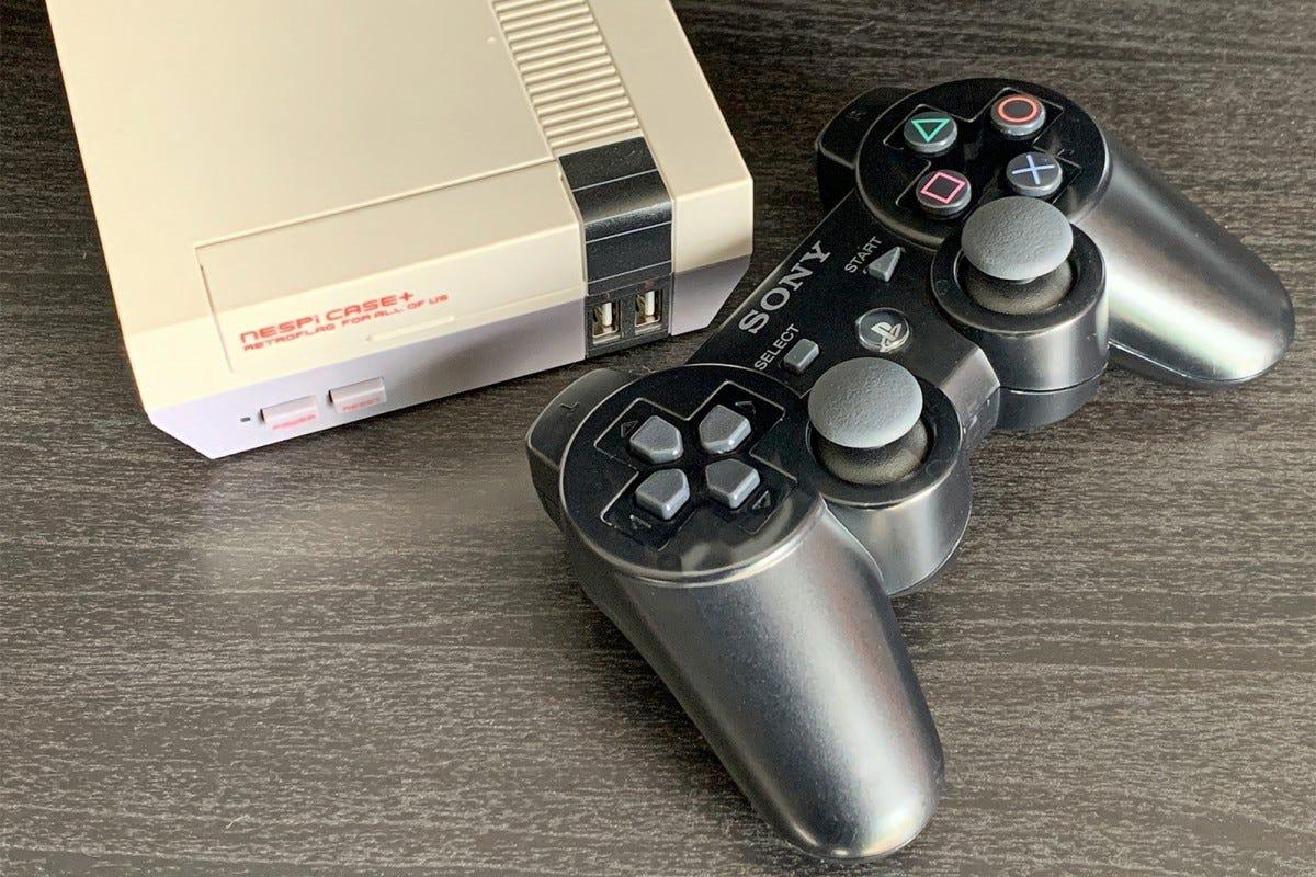 PS3 controller next to a Nespi Case+