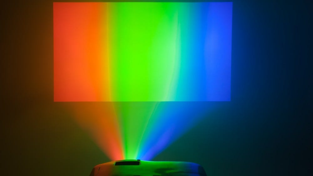 A projector broadcasting red, green, and blue