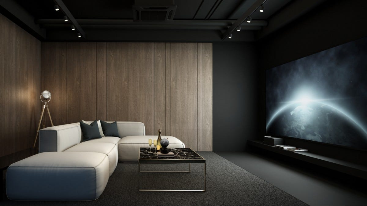 A media room with a large TV.