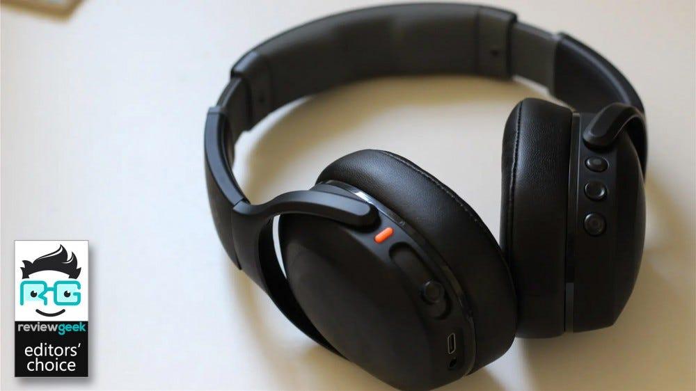 The Skullcandy Crusher Evo headphones in black lying on a white desktop