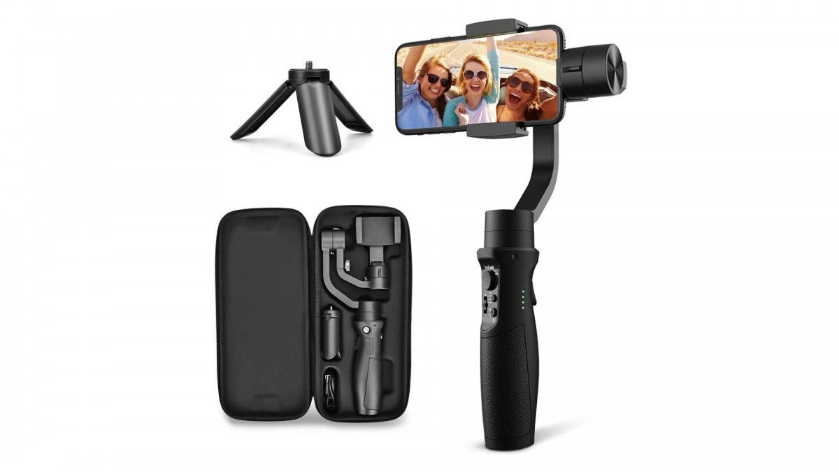 The Hohem three-axis gimbal holding a smartphone next to its case full of accessories.