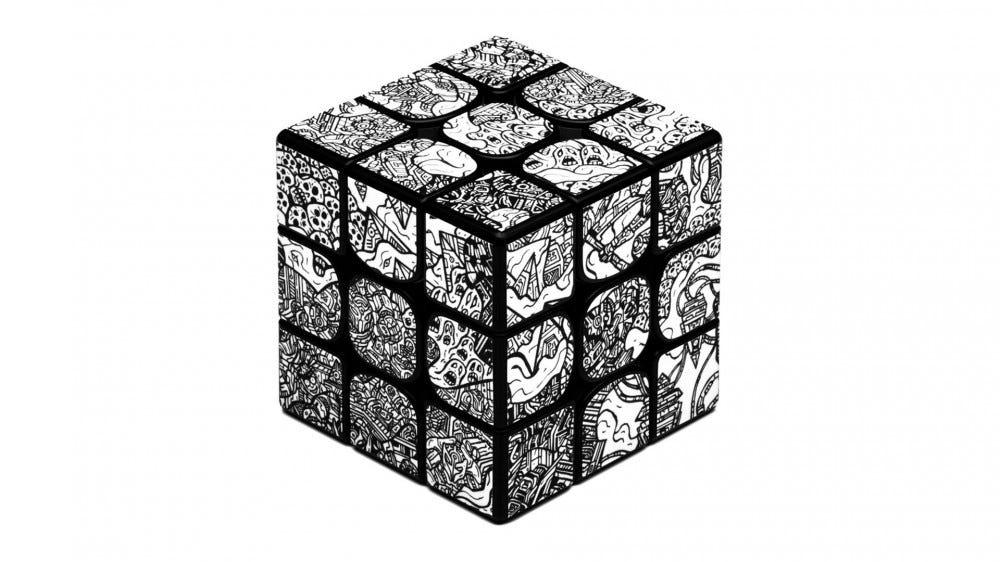 Rubik kocka stílusú rejtvény, amelyet dbrand Robot Camo bőre borít.