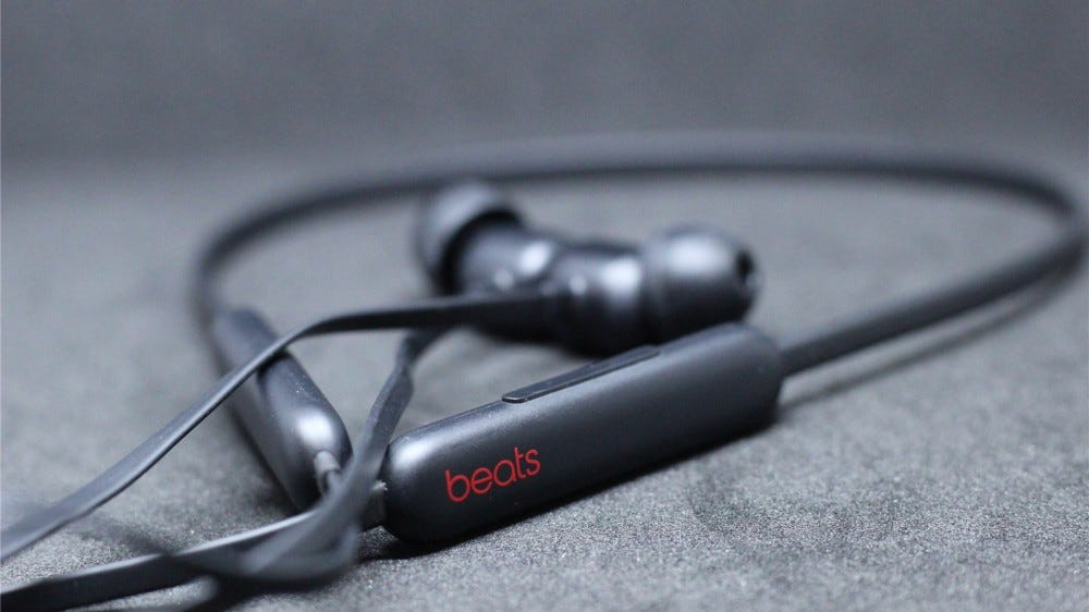 The Beats Flex in black on a black background