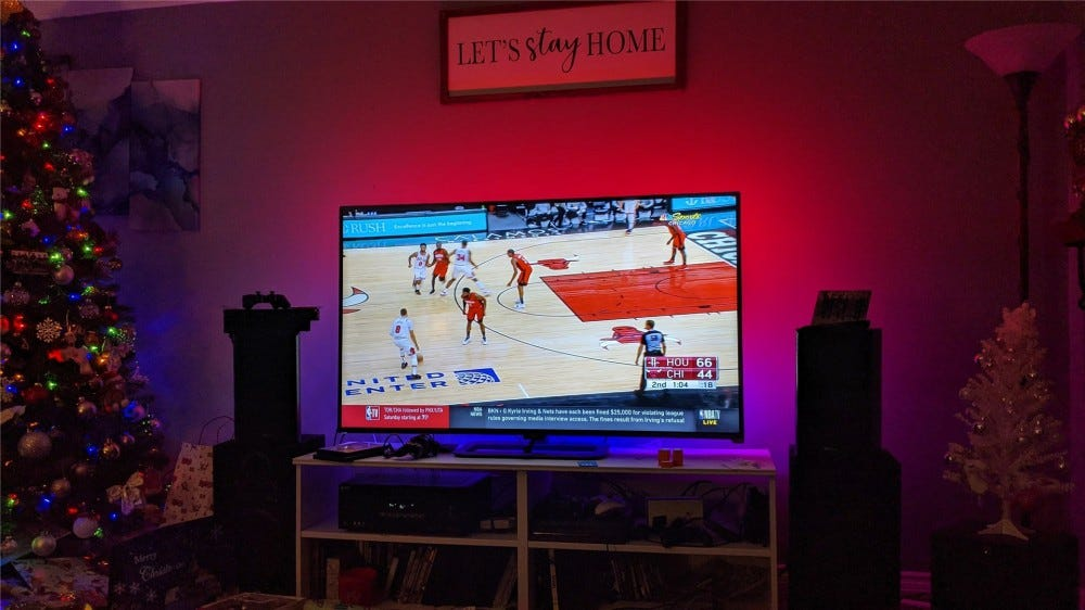 A Chicago Bulls basketball game on the TV with the Immersion displaying red and blue lights