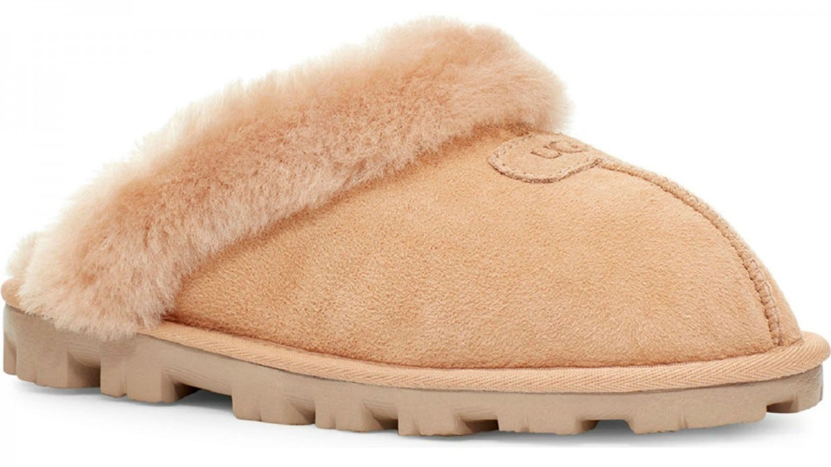 One UGG Genuine Shearling Slipper in chestnut.