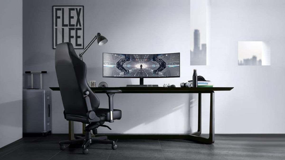 Samsung Odyssey G9 monitor on a desk near a gaming chair