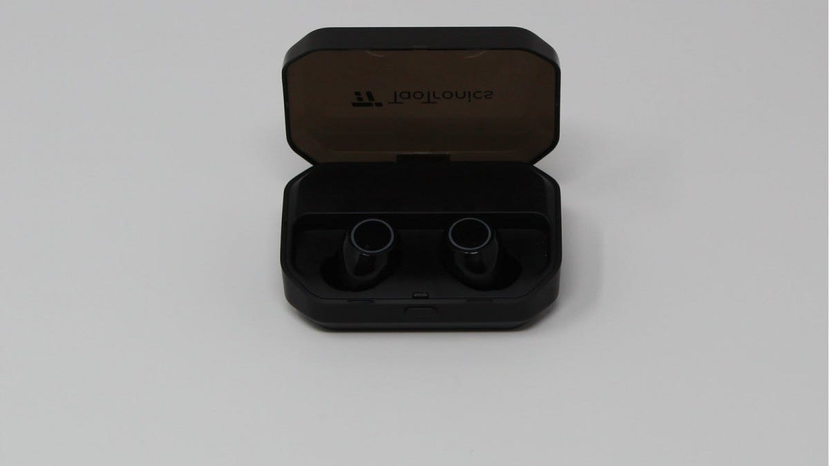 TaoTronics earbuds in the case with the lid open.
