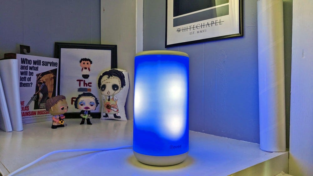 """The Aura Lamp with the """"Snow Flake"""" setting enabled, blue and white lights"""