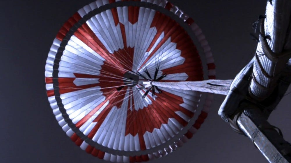 A picture of the red-and-white parachute of the Mars rover.