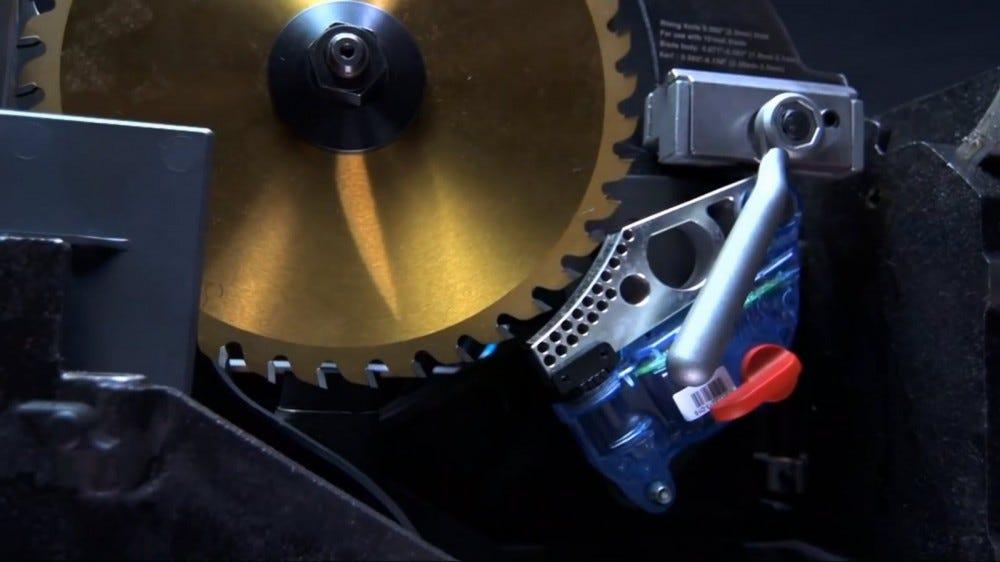 A metal brake next to a saw blade.