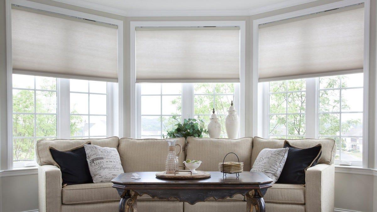Lutron Serena shades covering three windows.