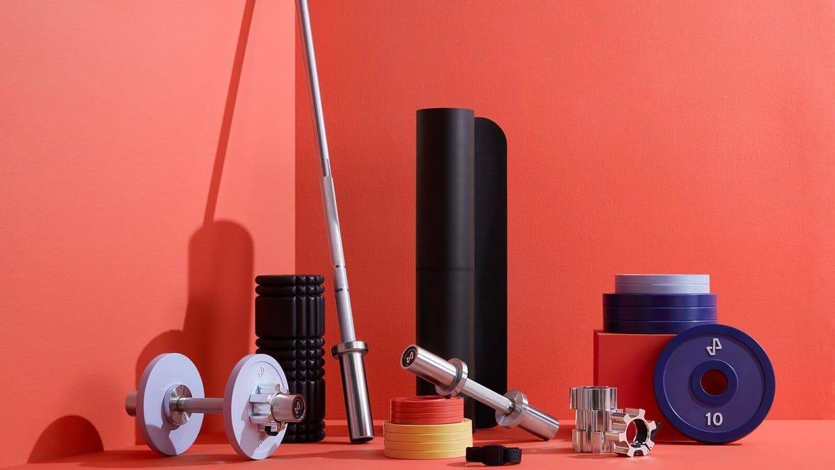 A set of umbells, a bar, weight plates, a workout matt, a heart monitor, and a recovery roller.