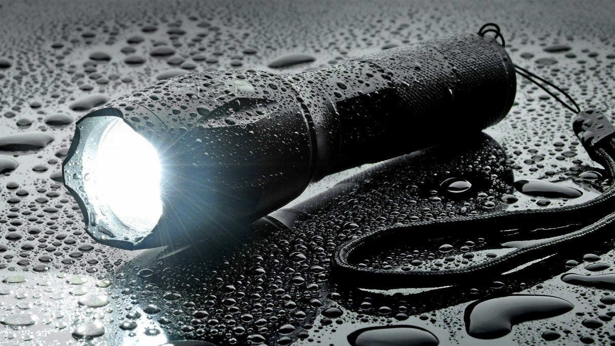 A tactical flashlight in the rain.
