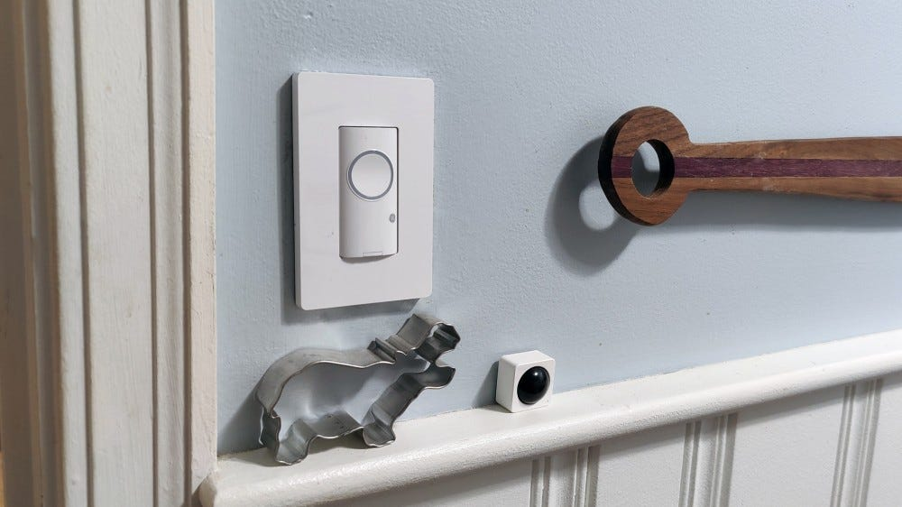 A smart Cync switch installed in a kitchen.