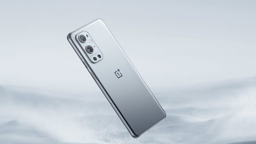 A OnePlus 9 Pro in morning mist grey colors.