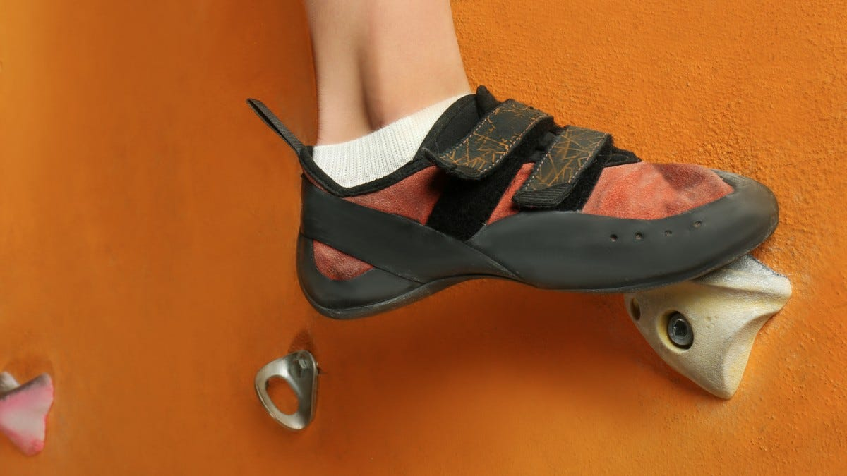 Climbing shoe on a foothold.
