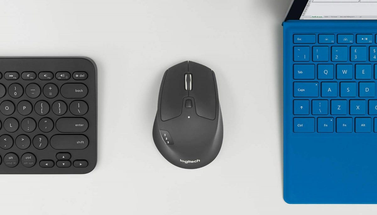 The Logitech M720, between two keyboards.