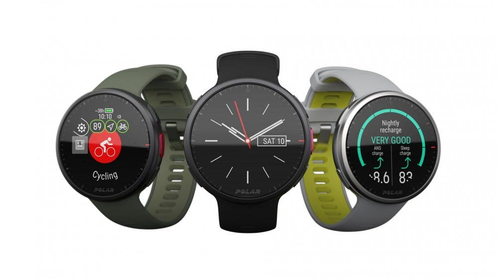 Three Polar fitness watches in grey, black, and green.