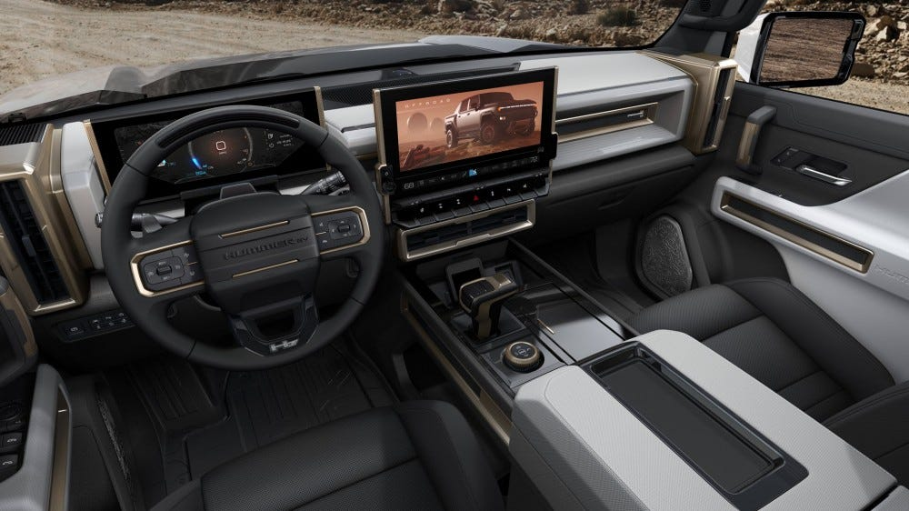The interior of a HUmmer EV, with a large horizontal touchscreen.