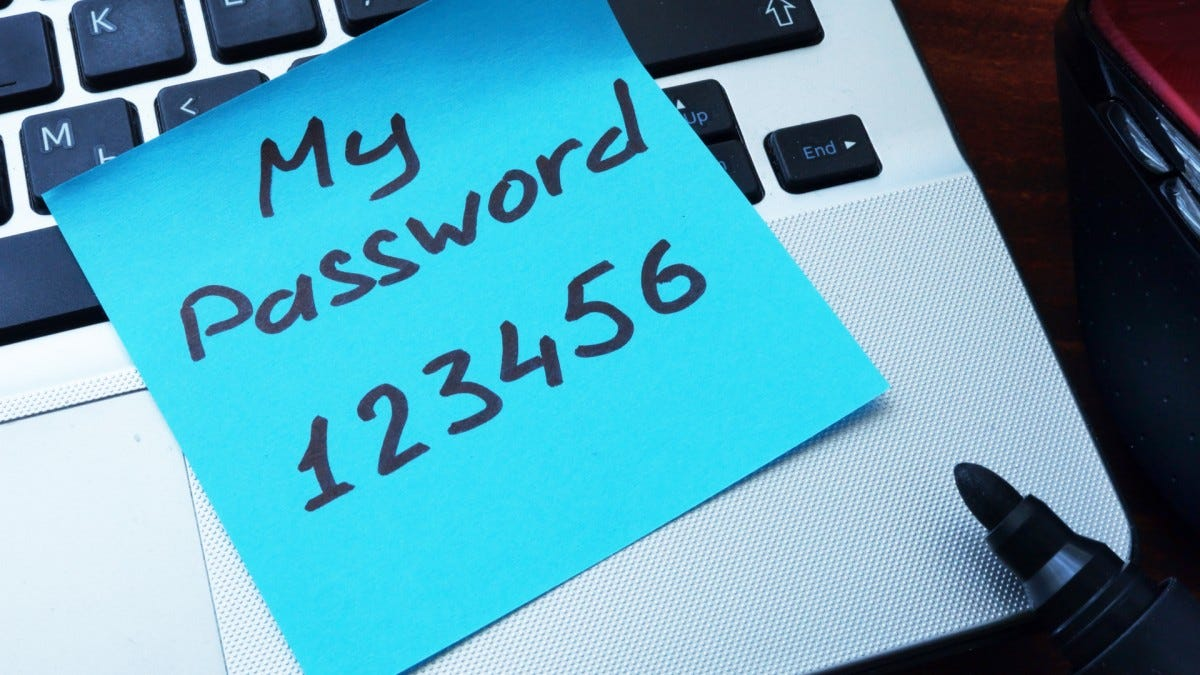 """My password 123456"" written on a paper with marker."