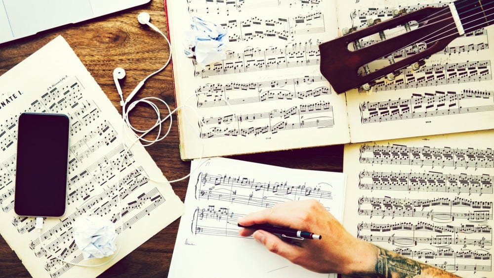 Learn music theory online with these resources write down notes for composition