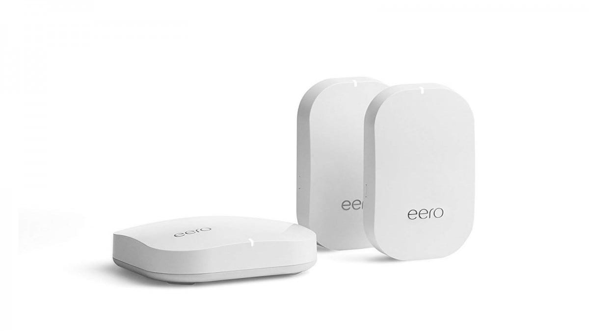 One eero pro router and two eero beacons against a white background.