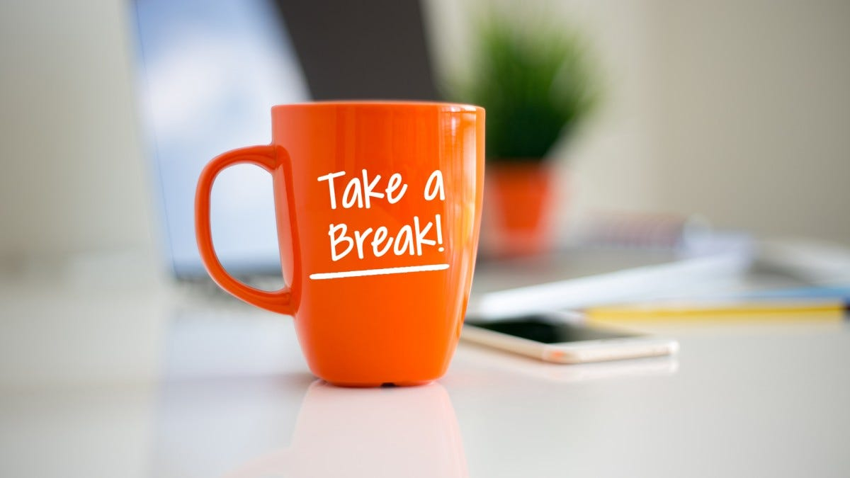 "A bright orange coffee cup with the words ""Take a Break!"" in white letters"