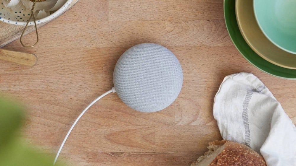 A photo of the Google Nest Mini speaker.