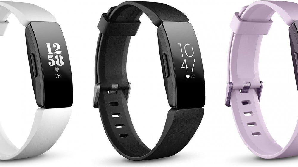 A photo of three Fitbit Inspire HR fitness bands.