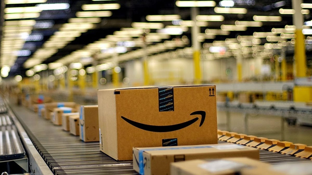 Amazon boxes rolling down a conveyor line.