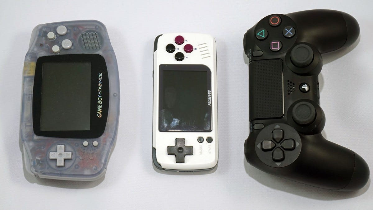 The PocketGo sitting next to the Game Boy Advance, and a PS4 controller.