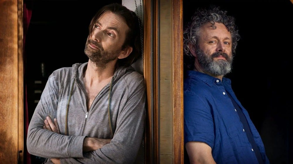 David Tennant and Michael Sheen standing side by side in a doorway.