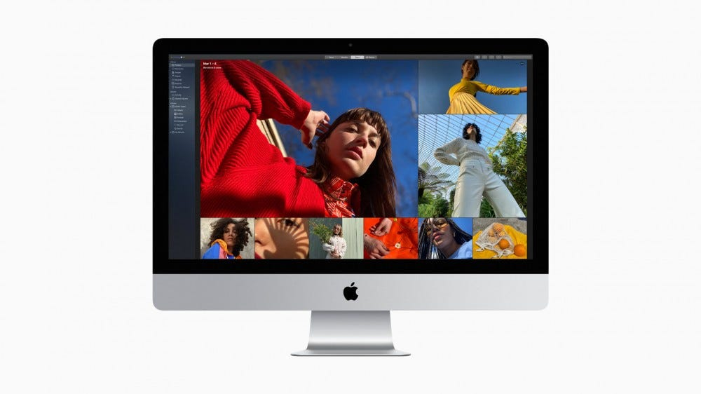 An iMac with Photoshop open.