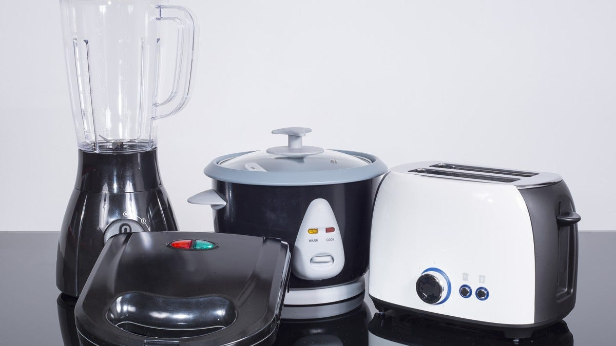 A variety of kitchen appliances, including a rice cooker.