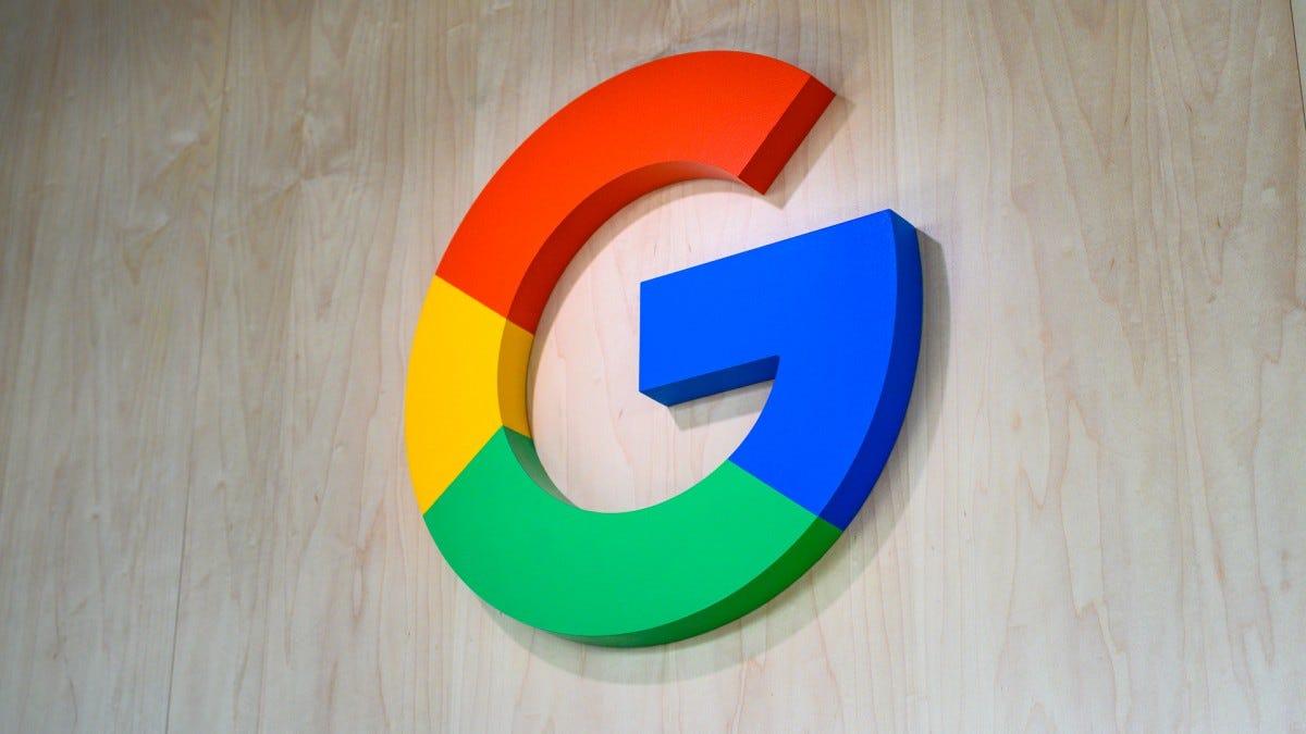 The Google Logo set against a wood background.