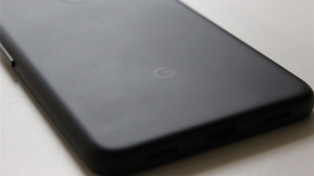 A close-up of the Google logo on the back of the Pixel 4a