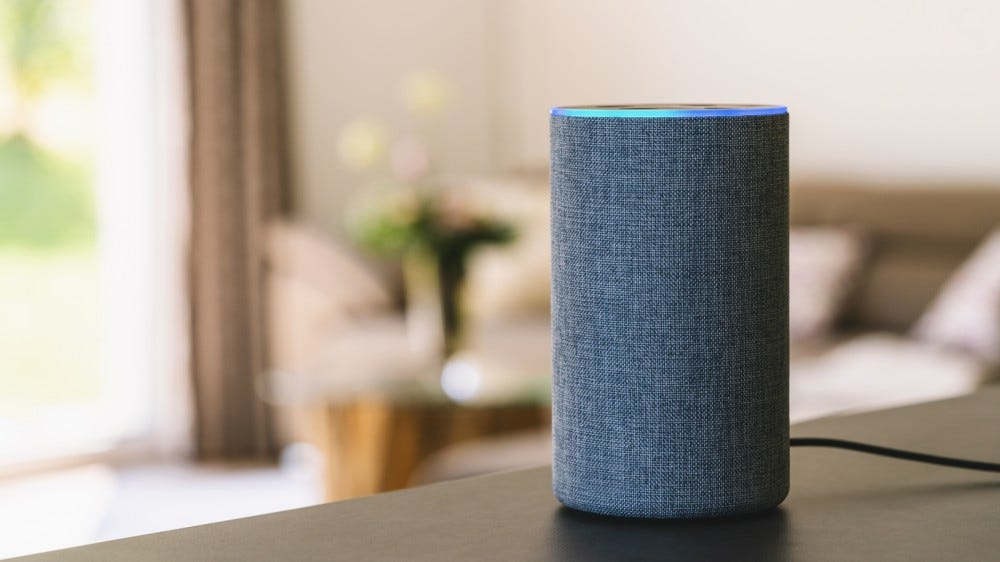 voice-controlled smart speaker on table in cozy room