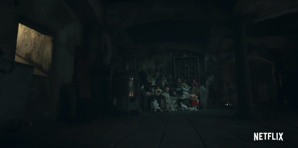 A collection of old dolls in a dark attic