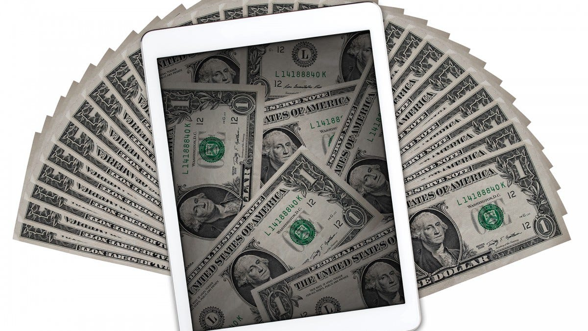 An iPad surrounded by $1 bills