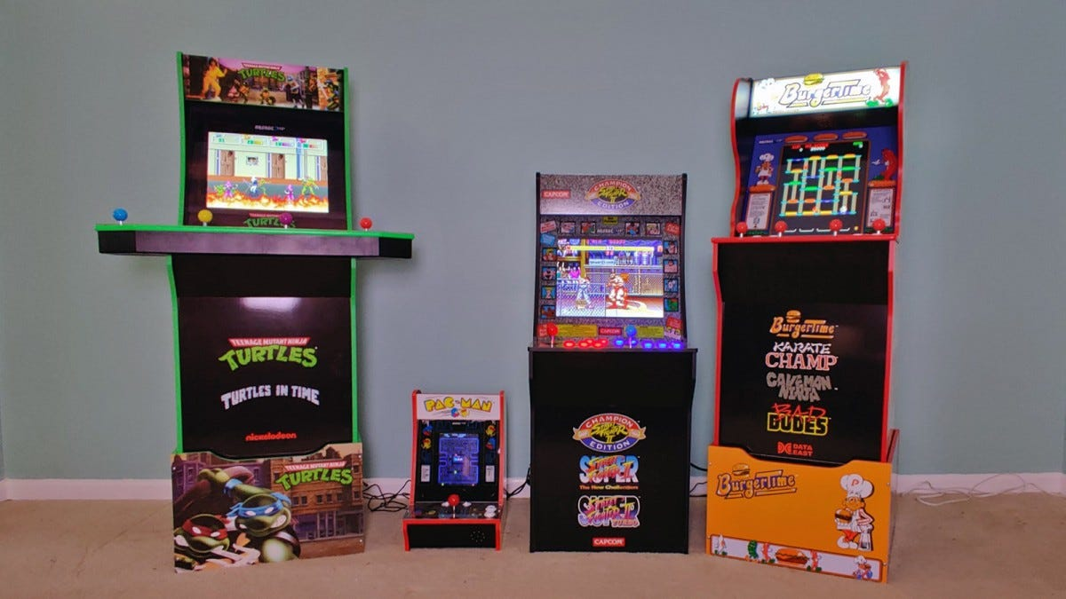 Four Arcade1Up machines: TMNT, Pac-Mac, Street Fighter, and Burger Time