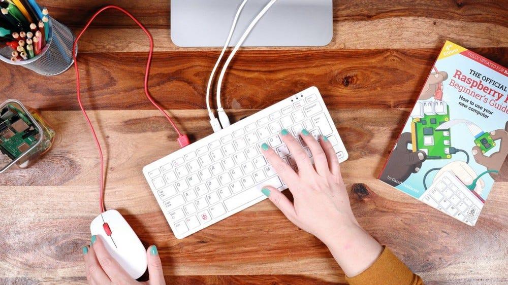 A Raspberry Pi keyboard plugged into a monitor