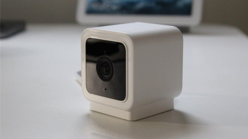 A Wyze Cam v3 in front of a Google Smart Display