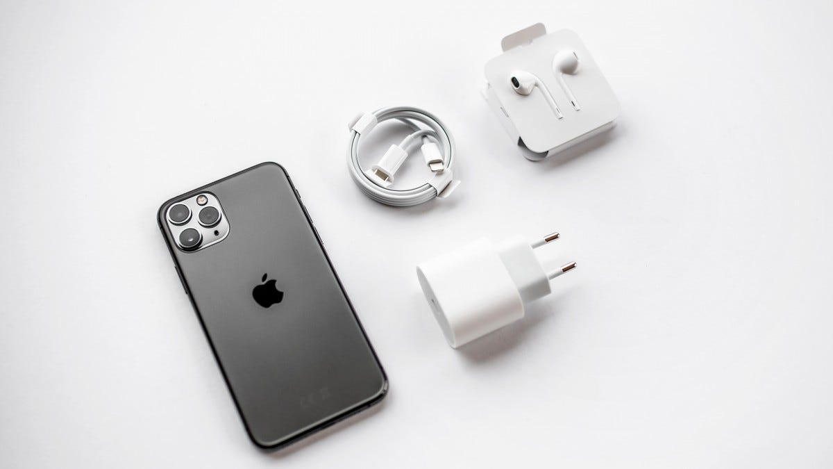 The iPhone 11 Pro with its charging accessories.