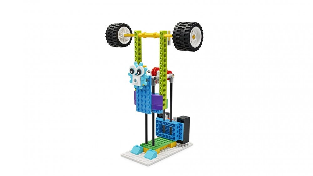 A LEGO set that looks like a weight-lifting center with a face.