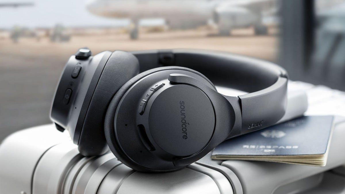 Phot of SoundCore headphones resting on a piece of luggage