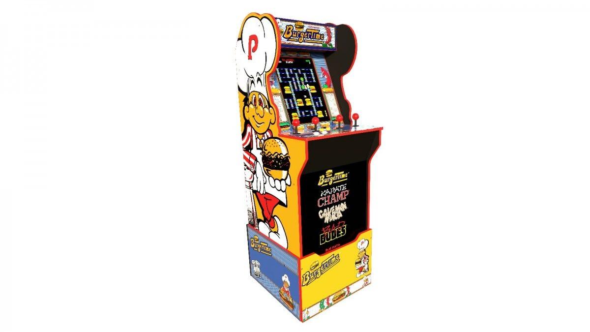 A Burger Time 3/4th scale arcade machine on a riser.