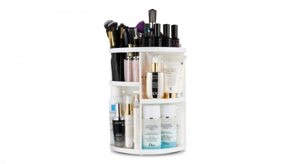 The Jerrybox 360 Degree Rotating Vanity Organizer loaded with makeup brushes, nail polish, and skincare products.