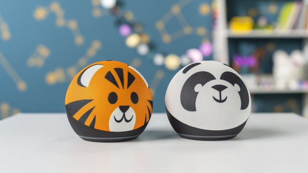 Two Echo Dots with a Tiger and Panda cover.